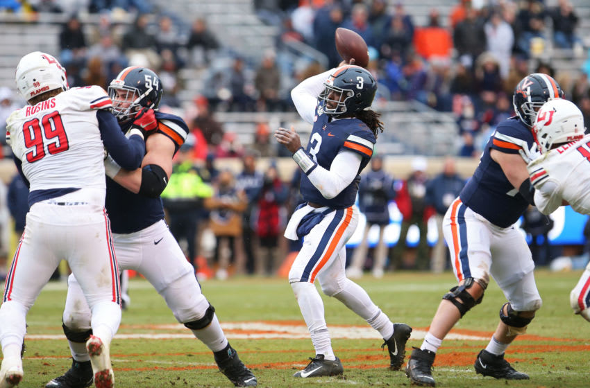 CHARLOTTESVILLE, VA - NOVEMBER 23: Bryce Perkins #3 of the Virginia Cavaliers throws a pass in the first half during a game against the Liberty Flames at Scott Stadium on November 23, 2019 in Charlottesville, Virginia. (Photo by Ryan M. Kelly/Getty Images)