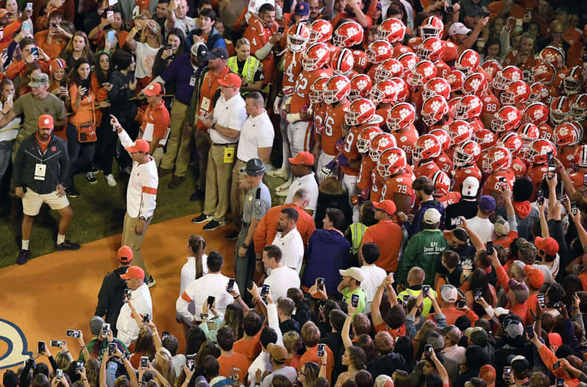 CLEMSON, SOUTH CAROLINA - OCTOBER 26: Head coach Dabo Swinney of the Clemson Tigers points to the sky as the Tigers prepare to run down the hill prior to their homecoming game against the Boston College Eagles at Memorial Stadium on October 26, 2019 in Clemson, South Carolina. (Photo by Mike Comer/Getty Images)