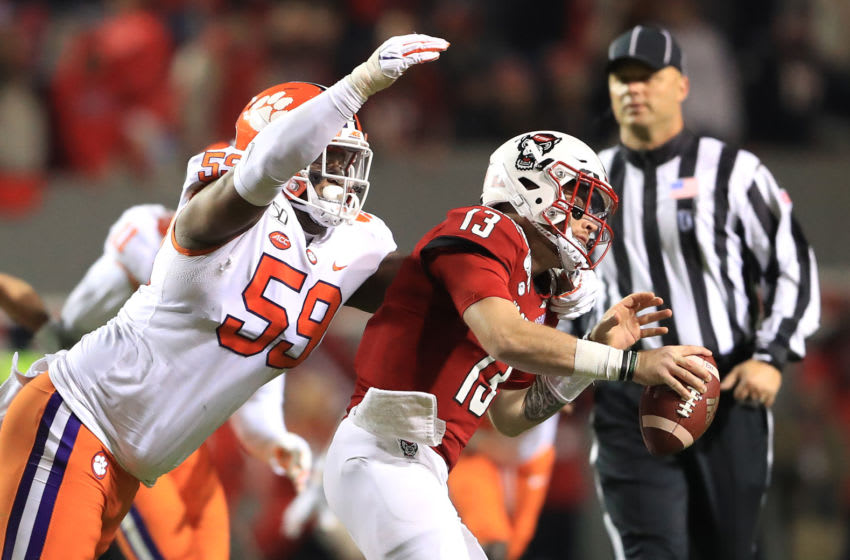 RALEIGH, NORTH CAROLINA - NOVEMBER 09: Jordan Williams #59 of the Clemson Tigers sacks Devin Leary #13 of the North Carolina State Wolfpack during their game at Carter-Finley Stadium on November 09, 2019 in Raleigh, North Carolina. (Photo by Streeter Lecka/Getty Images)