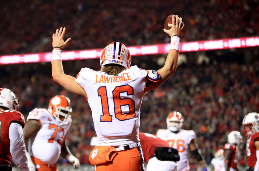 RALEIGH, NORTH CAROLINA - NOVEMBER 09: Trevor Lawrence #16 of the Clemson Tigers reacts after scoring a touchdown against the North Carolina State Wolfpack during their game at Carter-Finley Stadium on November 09, 2019 in Raleigh, North Carolina. (Photo by Streeter Lecka/Getty Images)