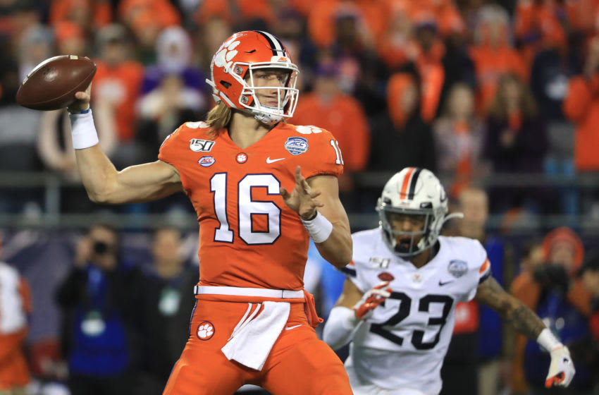 CHARLOTTE, NORTH CAROLINA - DECEMBER 07: Trevor Lawrence #16 of the Clemson Tigers drops back to pass against the Virginia Cavaliers during the ACC Football Championship game at Bank of America Stadium on December 07, 2019 in Charlotte, North Carolina. (Photo by Streeter Lecka/Getty Images)