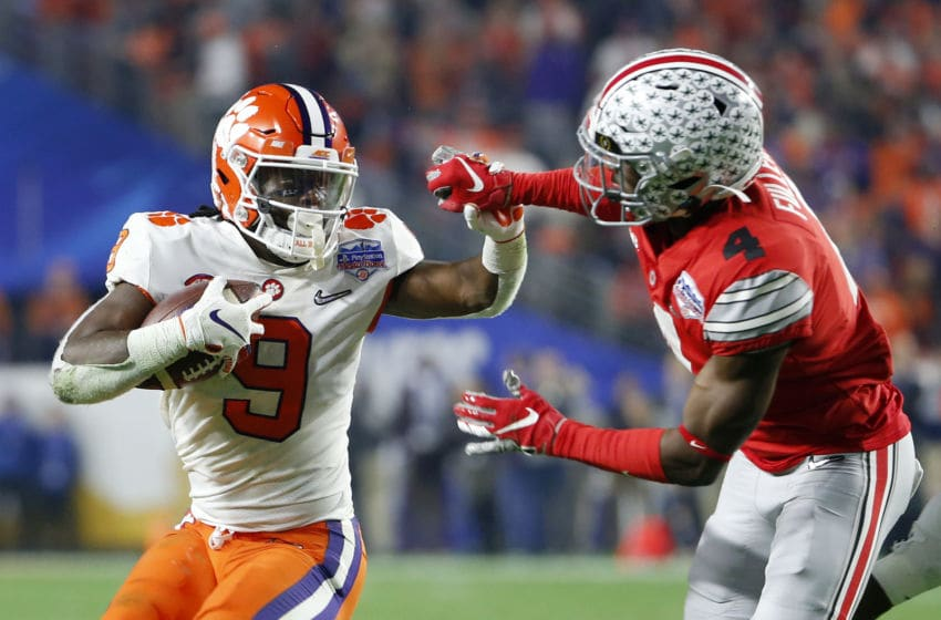 GLENDALE, ARIZONA - DECEMBER 28: Travis Etienne #9 of the Clemson Tigers runs the ball against Jordan Fuller #4 of the Ohio State Buckeyes during the College Football Playoff Semifinal at the PlayStation Fiesta Bowl at State Farm Stadium on December 28, 2019 in Glendale, Arizona. (Photo by Ralph Freso/Getty Images)