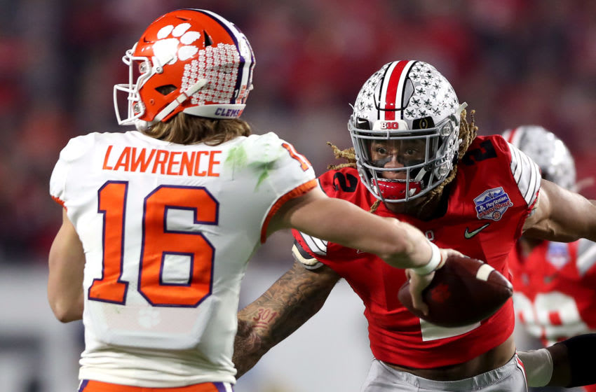 GLENDALE, ARIZONA - DECEMBER 28: Chase Young #2 of the Ohio State Buckeyes pursues Trevor Lawrence #16 of the Clemson Tigers in the first half during the College Football Playoff Semifinal at the PlayStation Fiesta Bowl at State Farm Stadium on December 28, 2019 in Glendale, Arizona. (Photo by Matthew Stockman/Getty Images)