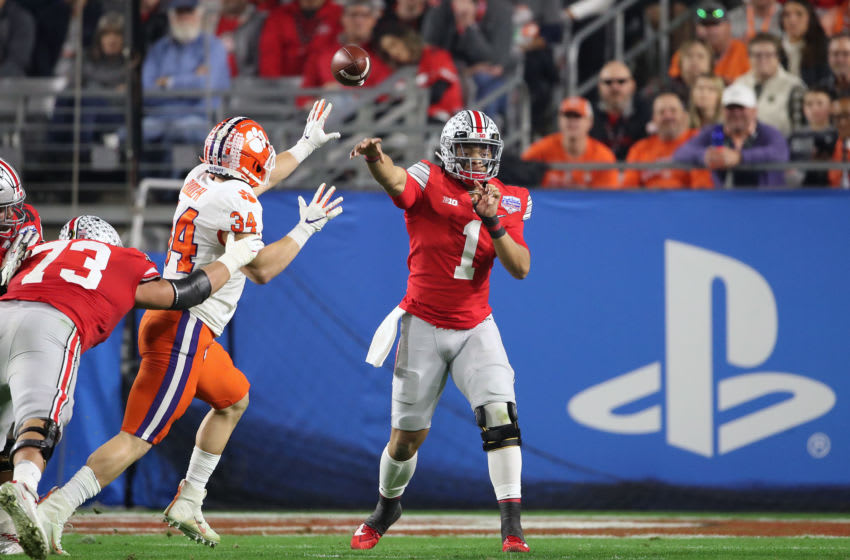 GLENDALE, ARIZONA - DECEMBER 28: Justin Fields #1 of the Ohio State Buckeyes attempts a pass under pressure from Logan Rudolph #34 of the Clemson Tigers in the first half during the College Football Playoff Semifinal at the PlayStation Fiesta Bowl at State Farm Stadium on December 28, 2019 in Glendale, Arizona. (Photo by Christian Petersen/Getty Images)