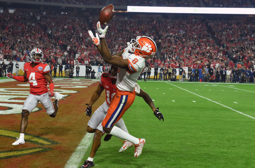 GLENDALE, ARIZONA - DECEMBER 28: Justyn Ross #8 of the Clemson Tigers attempts to catch a pass against the Ohio State Buckeyes in the first half during the College Football Playoff Semifinal at the PlayStation Fiesta Bowl at State Farm Stadium on December 28, 2019 in Glendale, Arizona. (Photo by Norm Hall/Getty Images)
