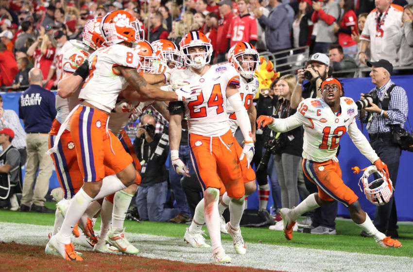 GLENDALE, ARIZONA - DECEMBER 28: Nolan Turner #24 of the Clemson Tigers is congratulated by his teammates after intercepting the ball in the final minute of the second half against the Ohio State Buckeyes during the College Football Playoff Semifinal at the PlayStation Fiesta Bowl at State Farm Stadium on December 28, 2019 in Glendale, Arizona. (Photo by Christian Petersen/Getty Images)