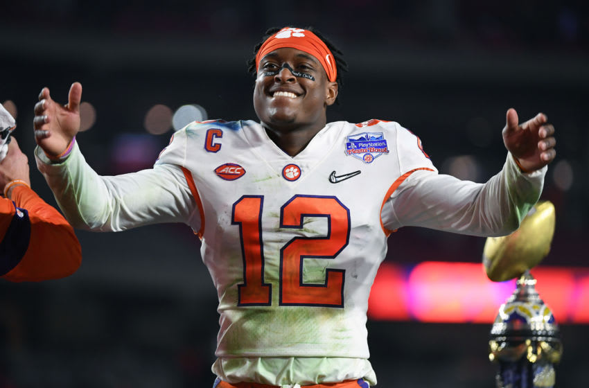 GLENDALE, ARIZONA - DECEMBER 28: K'Von Wallace #12 of the Clemson Tigers celebrates his teams 29-23 win over the Ohio State Buckeyes in the College Football Playoff Semifinal at the PlayStation Fiesta Bowl at State Farm Stadium on December 28, 2019 in Glendale, Arizona. (Photo by Norm Hall/Getty Images)