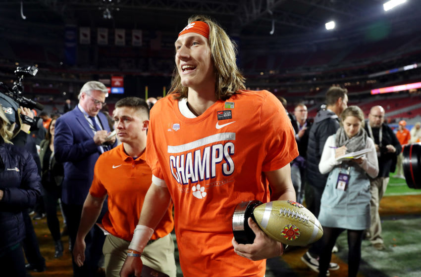 GLENDALE, ARIZONA - DECEMBER 28: Trevor Lawrence #16 of the Clemson Tigers celebrates his teams 29-23 win over the Ohio State Buckeyes in the College Football Playoff Semifinal at the PlayStation Fiesta Bowl at State Farm Stadium on December 28, 2019 in Glendale, Arizona. (Photo by Matthew Stockman/Getty Images)