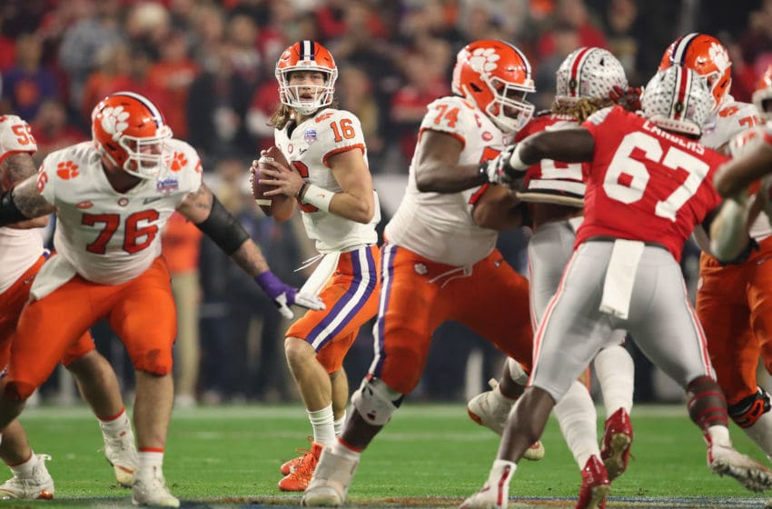 GLENDALE, ARIZONA - DECEMBER 28: Quarterback Trevor Lawrence #16 of the Clemson Tigers drops back to pass during the PlayStation Fiesta Bowl against the Ohio State Buckeyes at State Farm Stadium on December 28, 2019 in Glendale, Arizona. The Tigers defeated the Buckeyes 29-23. (Photo by Christian Petersen/Getty Images)