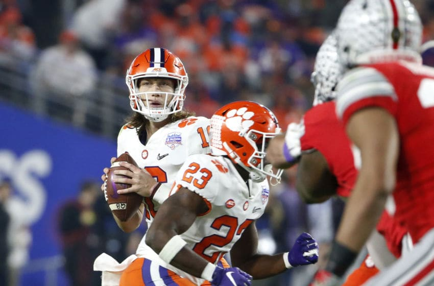 GLENDALE, ARIZONA - DECEMBER 28: Quarterback Trevor Lawrence #16 of the Clemson Tigers looks to pass against the Ohio State Buckeyes during the first half of the College Football Playoff Semifinal at the PlayStation Fiesta Bowl at State Farm Stadium on December 28, 2019 in Glendale, Arizona. (Photo by Ralph Freso/Getty Images)