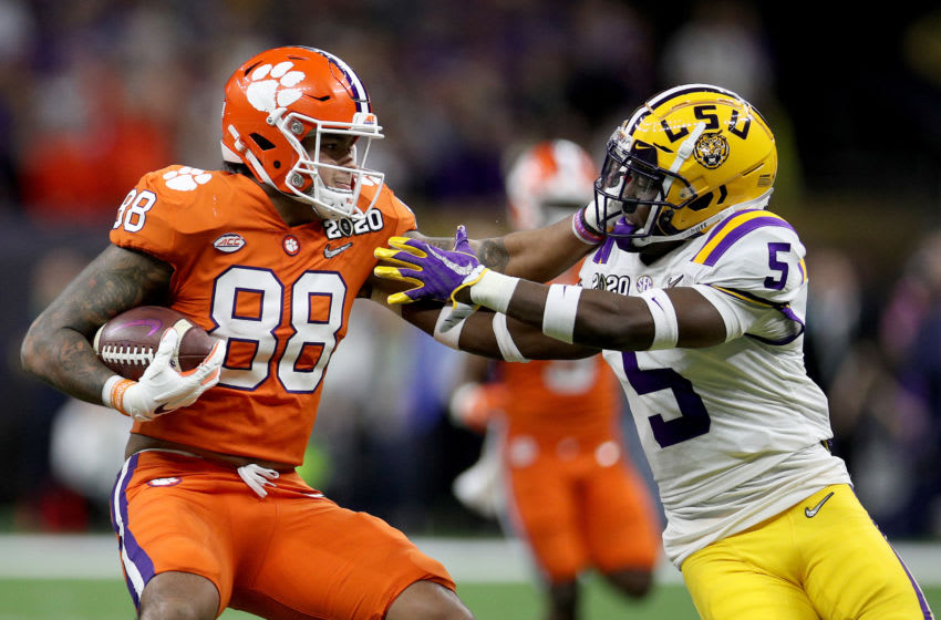 NEW ORLEANS, LOUISIANA - JANUARY 13: Braden Galloway #88 of the Clemson Tigers stiff arm Kary Vincent Jr. #5 of the LSU Tigers during the first half in the College Football Playoff National Championship game at Mercedes Benz Superdome on January 13, 2020 in New Orleans, Louisiana. (Photo by Chris Graythen/Getty Images)