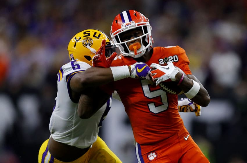 NEW ORLEANS, LOUISIANA - JANUARY 13: Jacob Phillips #6 of the LSU Tigers tackles Tee Higgins #5 of the Clemson Tigers during the first half in the College Football Playoff National Championship game at Mercedes Benz Superdome on January 13, 2020 in New Orleans, Louisiana. (Photo by Jonathan Bachman/Getty Images)
