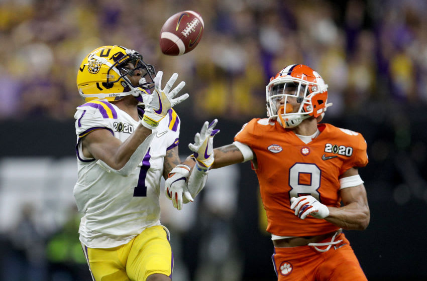 NEW ORLEANS, LOUISIANA - JANUARY 13: Ja'Marr Chase #1 of the LSU Tigers scores a touchdown as A.J. Terrell #8 of the Clemson Tigers defends in the College Football Playoff National Championship game at Mercedes Benz Superdome on January 13, 2020 in New Orleans, Louisiana. (Photo by Chris Graythen/Getty Images)