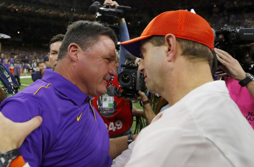 NEW ORLEANS, LOUISIANA - JANUARY 13: Head coach Ed Orgeron of the LSU Tigers and head coach Dabo Swinney congratulate each other after the 42-25 win in the College Football Playoff National Championship game at Mercedes Benz Superdome on January 13, 2020 in New Orleans, Louisiana. (Photo by Jonathan Bachman/Getty Images)