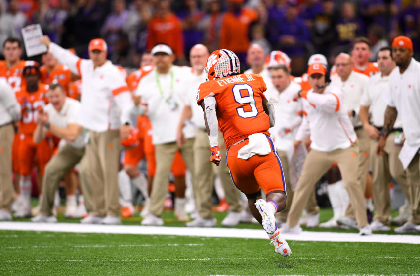 NEW ORLEANS, LA - JANUARY 13: Travis Etienne #9 of the Clemson Tigers rushes against the LSU Tigers during the College Football Playoff National Championship held at the Mercedes-Benz Superdome on January 13, 2020 in New Orleans, Louisiana. (Photo by Jamie Schwaberow/Getty Images)