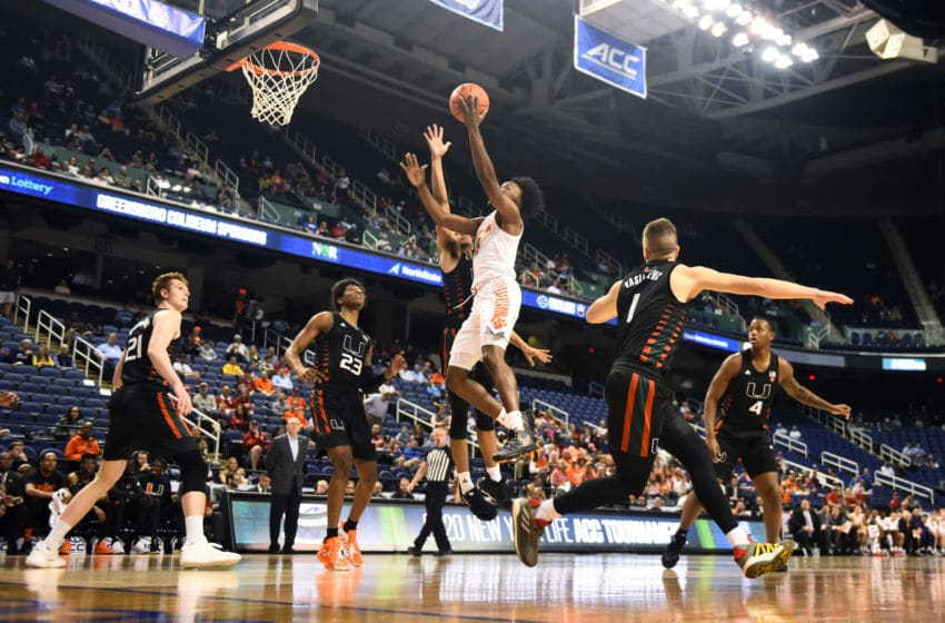 GREENSBORO, NORTH CAROLINA - MARCH 11: John Newman III #15 of the Clemson Tigers attempts a shot against the Miami Hurricanes during their game in the second round of the 2020 Men's ACC Basketball Tournament at Greensboro Coliseum on March 11, 2020 in Greensboro, North Carolina. (Photo by Jared C. Tilton/Getty Images)