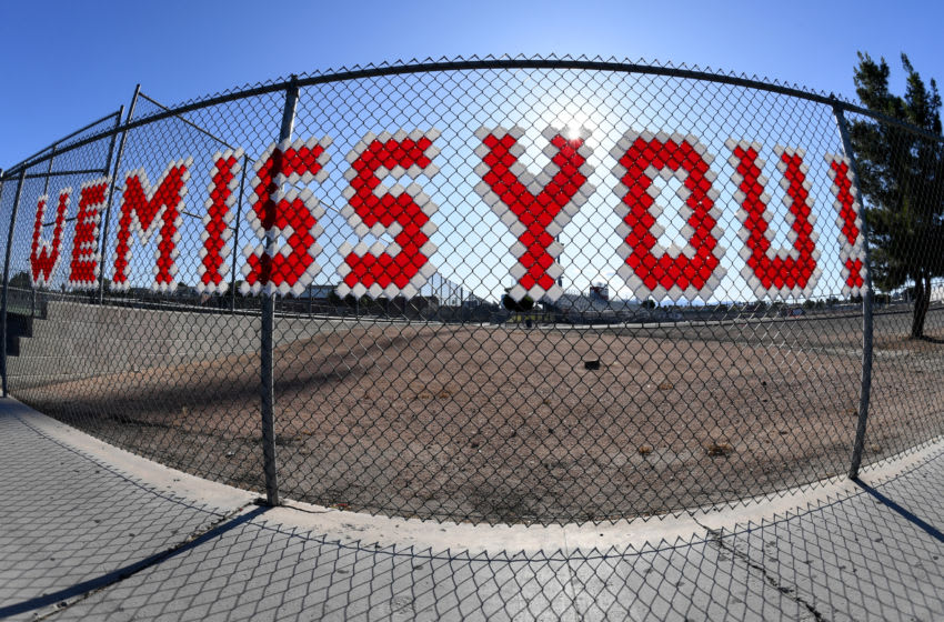 LAS VEGAS, NEVADA - MAY 20: (EDITORS NOTE: This image was shot with a fisheye lens.) Letters posted on a fence outside the football field at Valley High School spell out the message