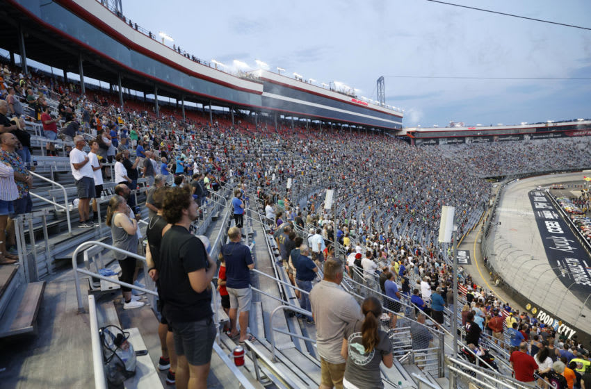 BRISTOL, TENNESSEE - JULY 15: Fans stand during pre-race ceremonies prior to the NASCAR Cup Series All-Star Race at Bristol Motor Speedway on July 15, 2020 in Bristol, Tennessee. (Photo by Patrick Smith/Getty Images)