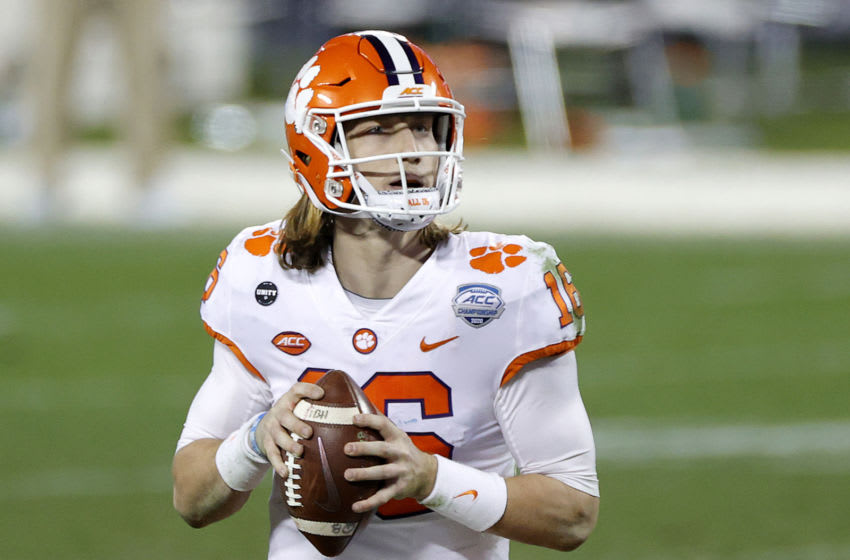 CHARLOTTE, NORTH CAROLINA - DECEMBER 19: Quarterback Trevor Lawrence #16 of the Clemson Tigers looks to pass in the fourth quarter against the Notre Dame Fighting Irish during the ACC Championship game at Bank of America Stadium on December 19, 2020 in Charlotte, North Carolina. (Photo by Jared C. Tilton/Getty Images)
