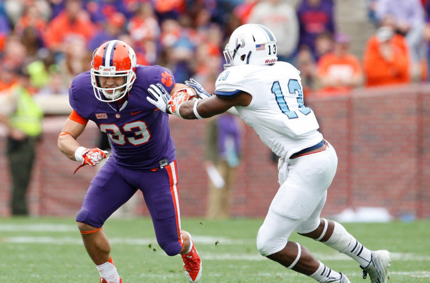 CLEMSON, SC - NOVEMBER 23: Daniel Rodriguez #83 of the Clemson Tigers tries to break past Cody Richardson #13 of the Citadel Bulldogs during the game at Memorial Stadium on November 23, 2013 in Clemson, South Carolina. (Photo by Tyler Smith/Getty Images)