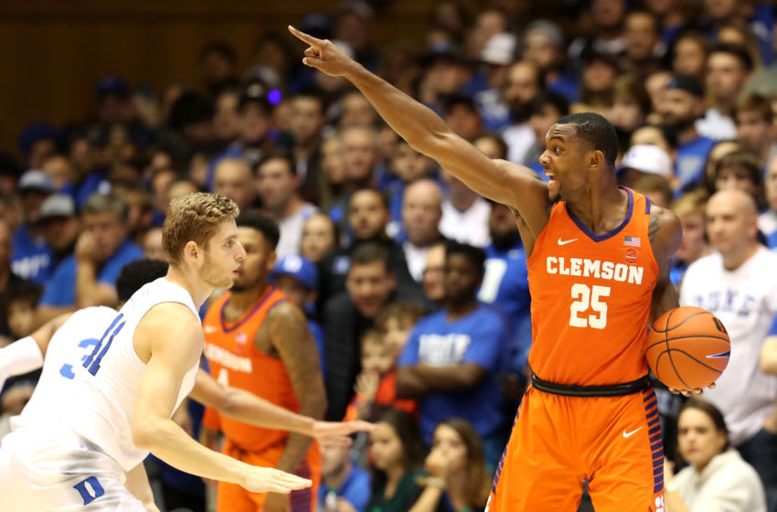 DURHAM, NORTH CAROLINA - JANUARY 05: Aamir Simms #25 of the Clemson Tigers reacts against Jack White #41 of the Duke Blue Devils during their game at Cameron Indoor Stadium on January 05, 2019 in Durham, North Carolina. (Photo by Streeter Lecka/Getty Images)