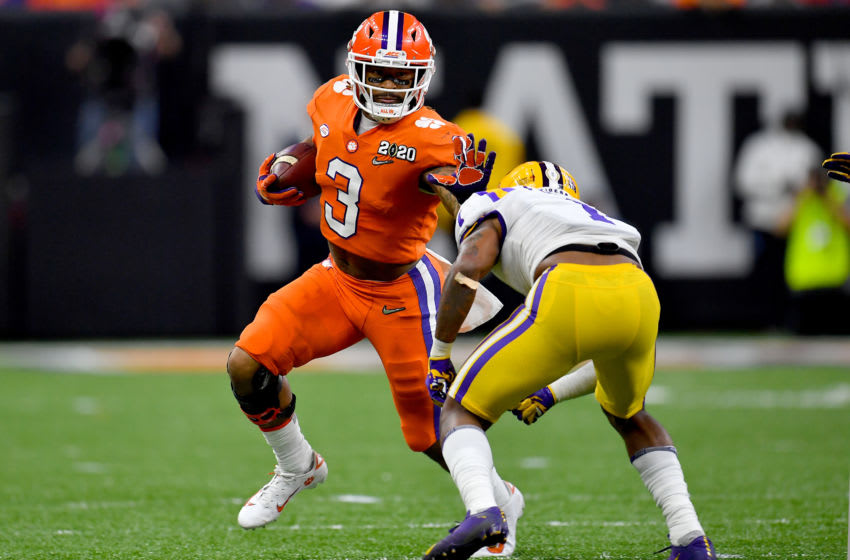 NEW ORLEANS, LOUISIANA - JANUARY 13: Amari Rodgers #3 of the Clemson Tigers gives Kristian Fulton #1 of the LSU Tigers a stiff arm during the second quarter of the College Football Playoff National Championship game at the Mercedes Benz Superdome on January 13, 2020 in New Orleans, Louisiana. The LSU Tigers topped the Clemson Tigers, 42-25. (Photo by Alika Jenner/Getty Images)