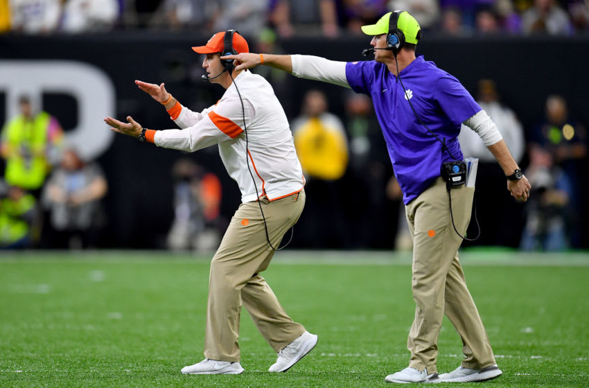 NEW ORLEANS, LOUISIANA - JANUARY 13: Head coach Dabo Swinney of the Clemson Tigers and defensive coordinator Brent Venables communicate with the team during the second quarter of the College Football Playoff National Championship game at the Mercedes Benz Superdome on January 13, 2020 in New Orleans, Louisiana. The LSU Tigers topped the Clemson Tigers, 42-25. (Photo by Alika Jenner/Getty Images)
