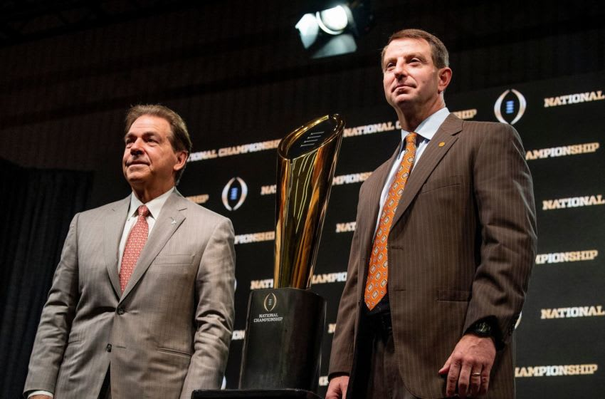 Alabama head coach Nick Saban and Clemson head coach Dabo Swinney pose with the National Championship trophy during the College Football National Championship coaches press conference in San Jose, Ca., on Sunday January 6, 2019. Cfptrophy01
