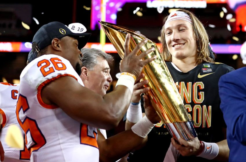 Jan 7, 2019; Santa Clara, CA, USA; Clemson Tigers quarterback Trevor Lawrence (16) celebrates with the national championship trophy after beating the Alabama Crimson Tide during the 2019 College Football Playoff Championship game at Levi's Stadium. Mandatory Credit: Matthew Emmons-USA TODAY Sports