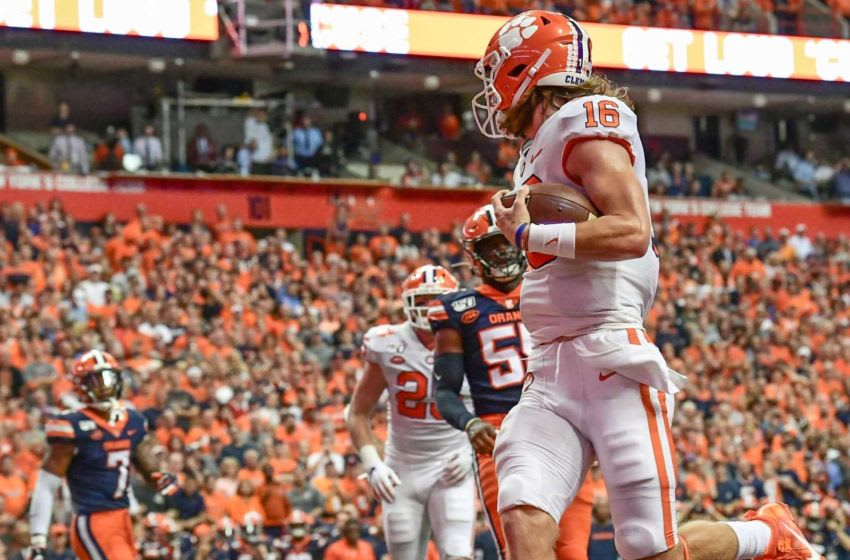 Clemson quarterback Trevor Lawrence (16) faked a hand- off to running back Lyn-J Dixon (23) and ran the ball in the end zone himself during the first quarter at the Carrier Dome in Syracuse, New York, Saturday, September 14, 2019. Clemson Football Syracuse 1h