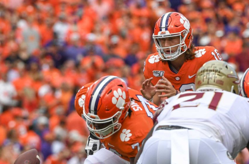 Clemson quarterback Trevor Lawrence (16) takes the snap with Florida State in Clemson, South Carolina Saturday, October 12, 2019. Clemson Fsu 2019