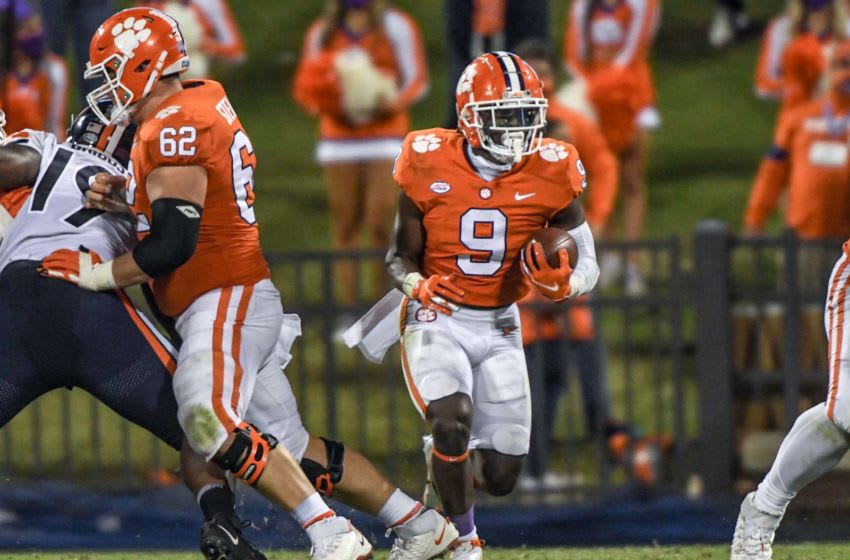 Clemson running back Travis Etienne(9) runs for a first down during the third quarter of the game with Virginia Saturday, October 3, 2020 at Memorial Stadium in Clemson, S.C. Clemson Virginia Ncaa Football