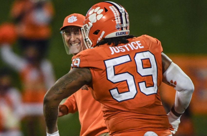 Clemson head coach Dabo Swinney smiles with Clemson defensive tackle Jordan Williams(59) after the Tigers beat Virginia 41-23 Saturday, October 3, 2020 at Memorial Stadium in Clemson, S.C. Clemson Virginia Ncaa Football