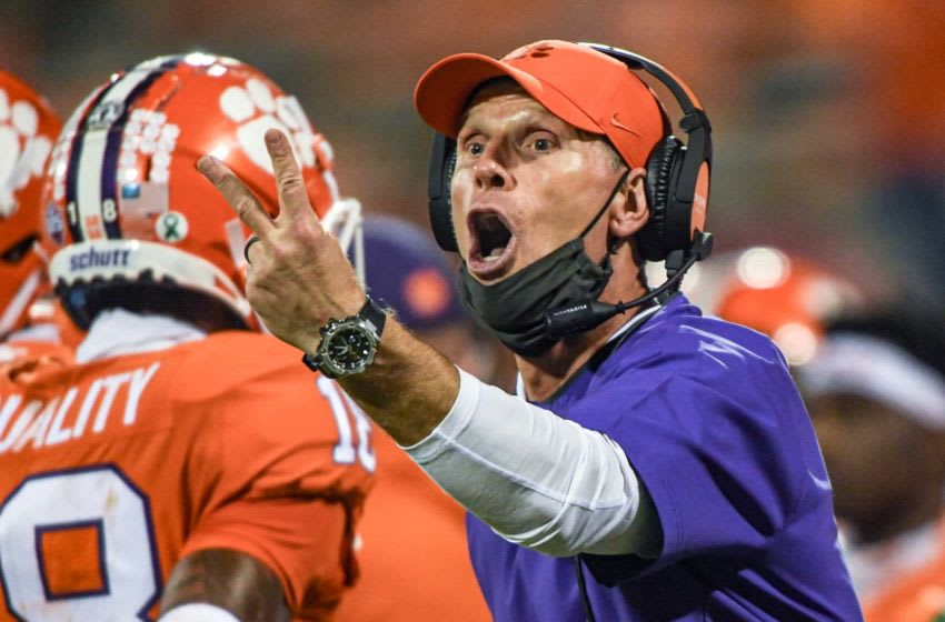 Oct 3, 2020; Clemson, SC, USA; Clemson defensive coordinator Brent Venables communicates with players in the Virginia game during the fourth quarter of the game on Saturday, October 3, 2020 at Memorial Stadium in Clemson, S.C. Mandatory Credit: Ken Ruinard-USA TODAY NETWORK