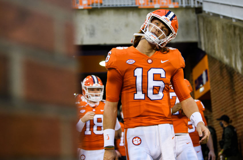 Oct 10, 2020; Clemson, South Carolina, USA; at Memorial Stadium. Clemson Tigers quarterback Trevor Lawrence (16) and other quarterbacks walk onto the field for warmups before a game against the Miami Hurricanes at Memorial Stadium. Mandatory Credit: Ken Ruinard-USA TODAY Sports