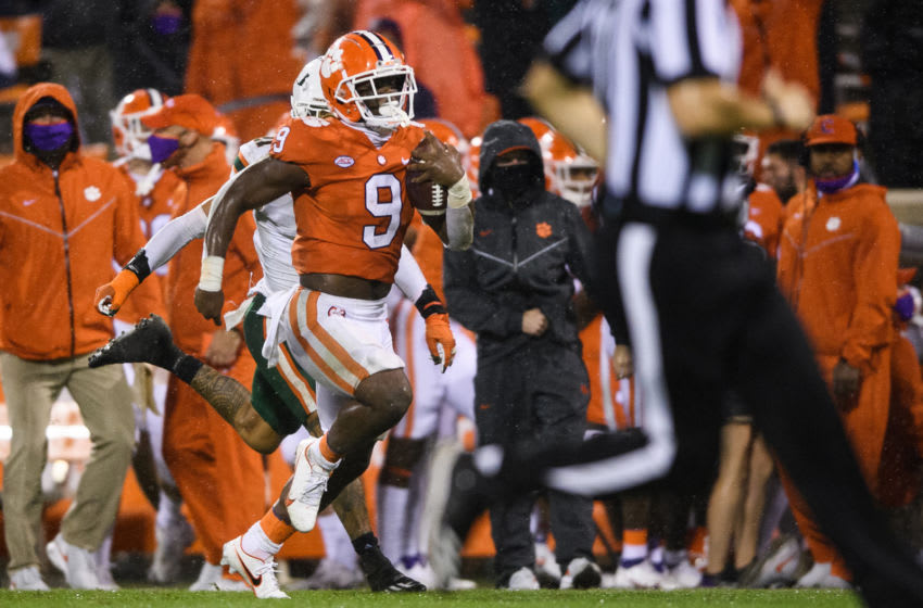 Oct 10, 2020; Clemson, South Carolina, USA; Clemson Tigers running back Travis Etienne (9) runs for a 72-yard touchdown against the Miami Hurricanes during the third quarter at Memorial Stadium. Mandatory Credit: Ken Ruinard-USA TODAY Sports