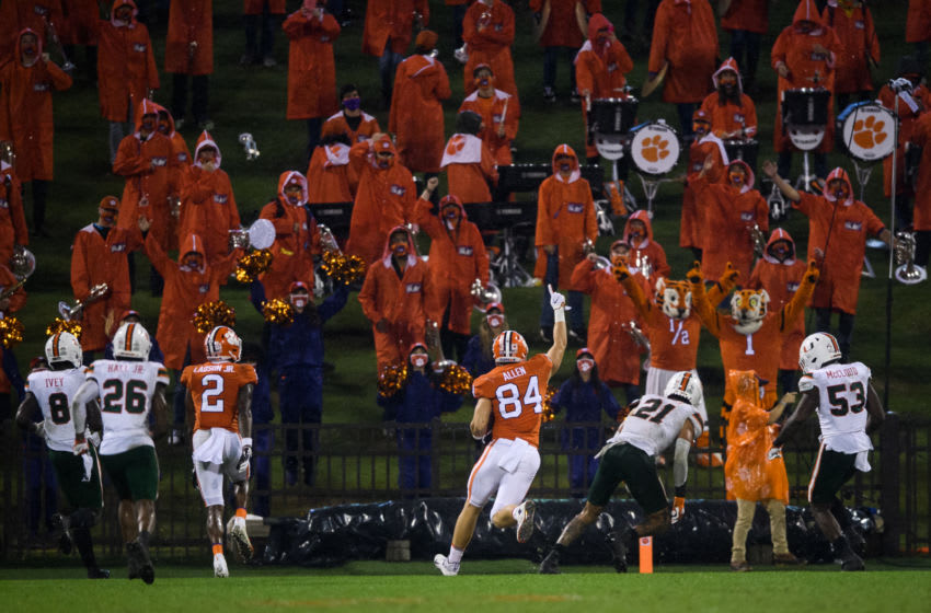 Oct 10, 2020; Clemson, South Carolina, USA; Clemson Tigers tight end Davis Allen (84) scores a touchdown against the Miami Hurricanes during the fourth quarter at Memorial Stadium. Mandatory Credit: Ken Ruinard-USA TODAY Sports