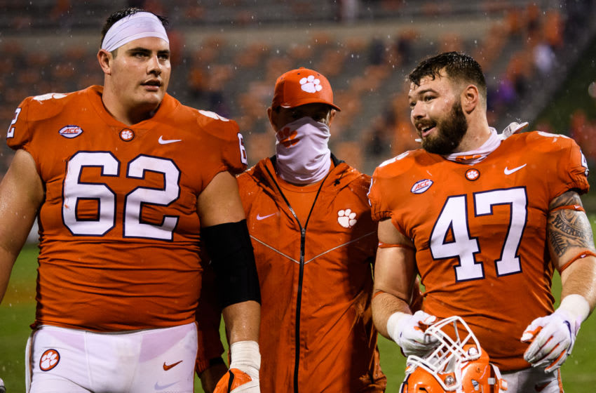 Oct 10, 2020; Clemson, South Carolina, USA; Clemson Tigers head coach Dabo Swinney (middle) walks off the field with offensive lineman Cade Stewart (62) and linebacker James Skalski (47) after defeating the Miami Hurricanes at Memorial Stadium. Mandatory Credit: Ken Ruinard-USA TODAY Sports