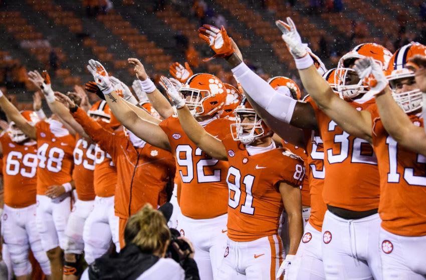 Oct 10, 2020; Clemson, South Carolina, USA; Clemson Tigers players celebrate after defeating the Miami Hurricanes at Memorial Stadium. Mandatory Credit: Ken Ruinard-USA TODAY Sports