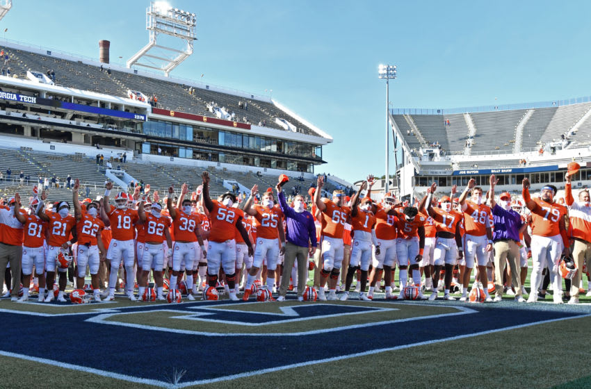 Oct 17, 2020; Atlanta, GA, USA; Clemson players and coaching staff wave to their fans after Clemson won 73-7 during an NCAA college football game at Bobby Dodd Stadium. Mandatory Credit: Hyosub Shin/Pool Photo-USA TODAY Sports