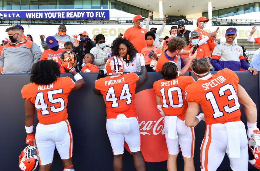 Oct 17, 2020; Atlanta, GA, USA; Clemson players celebrate with family members and friends after Clemson won 73-7 during an NCAA college football game at Bobby Dodd Stadium. Mandatory Credit: Hyosub Shin/Pool Photo-USA TODAY Sports