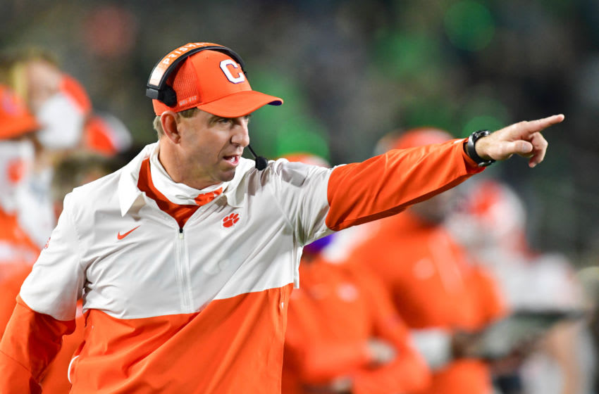 Nov 7, 2020; South Bend, Indiana, USA; Clemson Tigers head coach Dabo Swinney signals to his players in the second quarter against the Notre Dame Fighting Irish at Notre Dame Stadium. Mandatory Credit: Matt Cashore-USA TODAY Sports