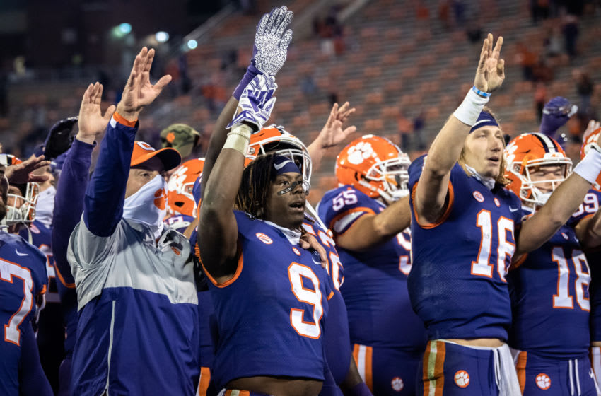 Nov 28, 2020; Clemson, SC, USA; Clemson running back Travis Etienne (9) and Clemson quarterback Trevor Lawrence (16) wave after defeating Pittsburgh 52-17 in their last home game with the team at Memorial Stadium. Mandatory Credit: Ken Ruinard-USA TODAY Sports