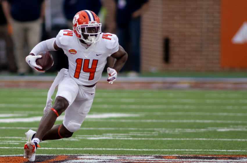 Jan 30, 2021; Mobile, AL, USA; American wide receiver Cornell Powell of Clemson (14) gets loose in the second half of the 2021 Senior Bowl at Hancock Whitney Stadium. Mandatory Credit: Vasha Hunt-USA TODAY Sports