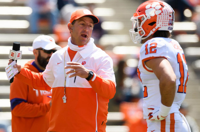 Clemson head coach Dabo Swinney speaks with safety Tyler Venables (12) during their annual spring game at Memorial Stadium Apr 3, 2021; Clemson, South Carolina, USA.