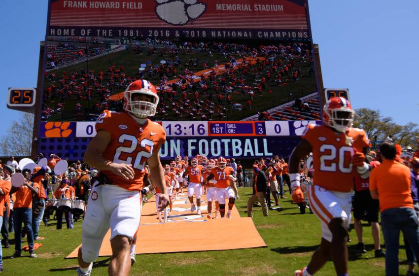 The orange team runs onto the field during their annual spring game at Memorial Stadium Apr 3, 2021; Clemson, South Carolina, USA.