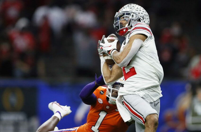 Ohio State Buckeyes wide receiver Chris Olave (2) makes a touchdown catch against Clemson Tigers cornerback Derion Kendrick (1) in the third quarter during the College Football Playoff semifinal at the Allstate Sugar Bowl in the Mercedes-Benz Superdome in New Orleans on Friday, Jan. 1, 2021. College Football Playoff Ohio State Faces Clemson In Sugar Bowl