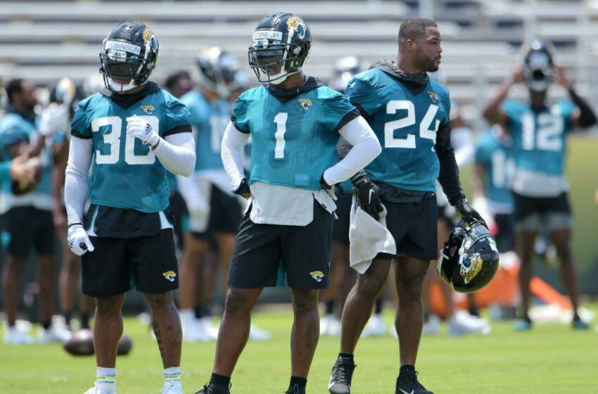Jaguars (30) RB James Robinson, (1) RB Travis Etienne Jr. and (24) RB Carlos Hyde on the field during drills at Thursday's OTA session, The Jacksonville Jaguars held their Thursday session of organized team activity at the practice fields outside TIAA Bank Field, May 27, 2021. [Bob Self/Florida Times-Union] Jki 052721 Jagsotas 35