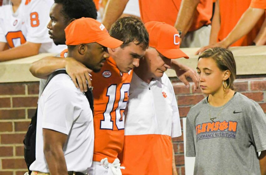 Clemson quarterback Will Taylor (16) is helped off the field with an ice pack on his knee during the first quarter at Memorial Stadium in Clemson, S.C., October 2, 2021. Ncaa Football Acc Clemson Boston College