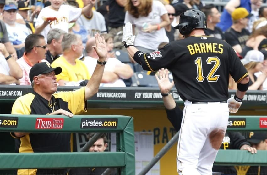 Jun 19, 2014; Pittsburgh, PA, USA; Pittsburgh Pirates manager Clint Hurdle (13) greets Pirates shortstop Clint Barmes (12) after Barmes scored a run on a balk call against Cincinnati Reds starting pitcher Homer Bailey (not pictured) during the fifth inning at PNC Park. Mandatory Credit: Charles LeClaire-USA TODAY Sports